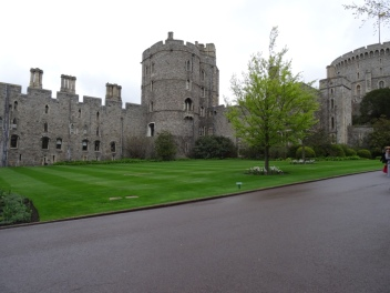 Windsor Castle with short lawn that is very green in foreground
