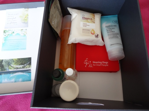 my pampering goodies inside my box, like moisturising lotion and bubble bath from the Spa Sanctuary range, perfume, face masks, notebook to write thoughts etc..