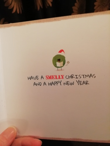 Inside of card which says have a smelly Christmas and a happy new year