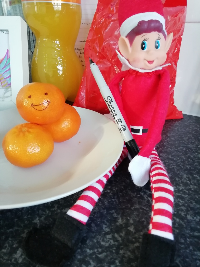 Elf drawing on the orange