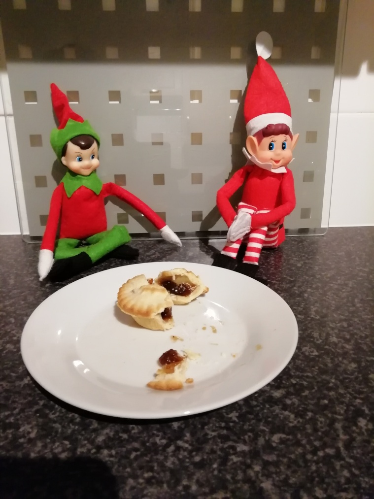 Nick and Noel eating a mince pie