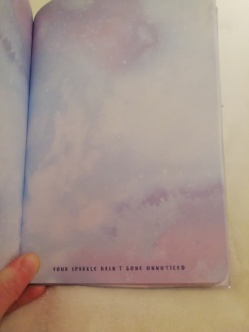 A page from my journal that is plain pastel blue with faint starry sky design