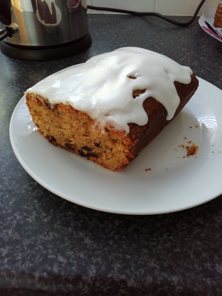 Lemon and orange marmalade cake with drizzled white icing
