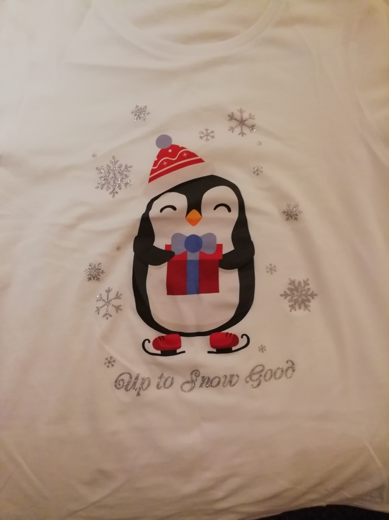 Christmas t-shirt with a penguin on it and words up to snow good