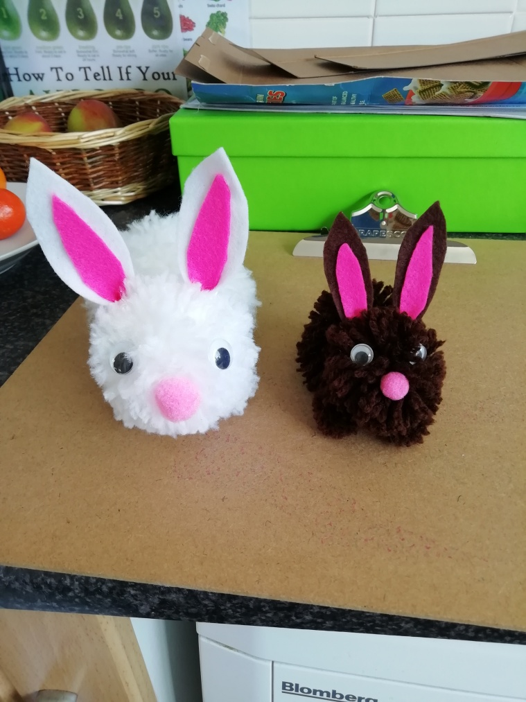 Brown and a white pom pom bunnies